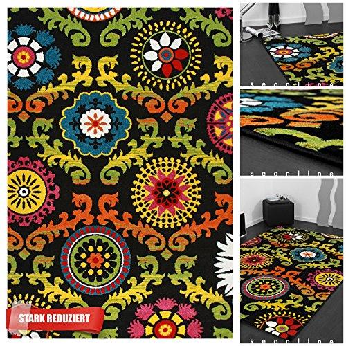exklusiver designer teppich mit leuchtenden ornamenten in bunt schwarz hochwertiger kurzflor. Black Bedroom Furniture Sets. Home Design Ideas