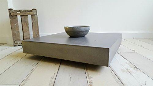 Massiver beton couchtisch schwebend und rollbar b k design for Beistelltisch rollbar